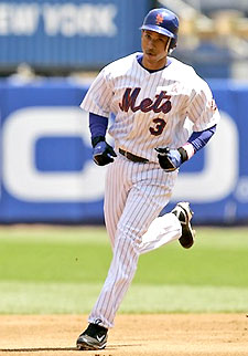 The New York Mets' Damion Easley trots around the bases after hitting a homerun