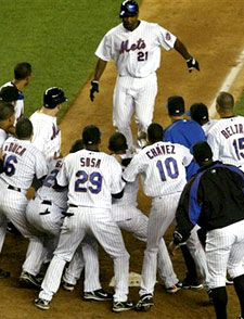 New York Mets Carlos Delgado scores after hitting the game-winning homerun against the San Francisco Giants