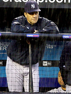 Joe Torre looks on as the Mets rain down on the Yankees