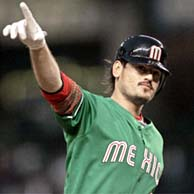 Team Mexico's Jorge Cantu points toward Shea