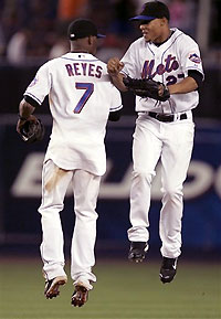 Jose Reyes and Carlos Gomez celebrate the Mets win over the Giants