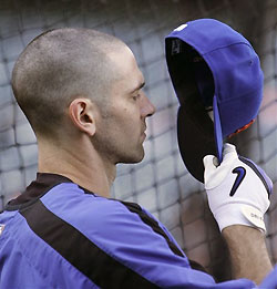 With a cleanly shaven head, Shawn Green wonders how he'll keep his hat on