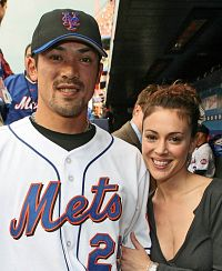 Alyssa Milano poses with Kaz Matsui of the New York Mets in 2006