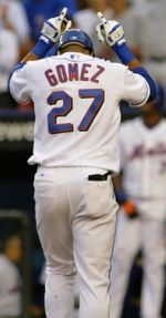 Mets outfielder Carlos Gomez steps on home plate after homering against the St. Louis Cardinalls