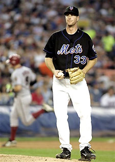 Mets pitcher John Maine allows a homerun to Arizona Diamondbacks catcher Chris Snyder