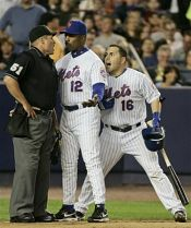 Paul LoDuca screams at the umpire behind Mets manager Willie Randolph