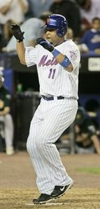 Mets catcher Ramon Castro scores the winning run against the Oakland Athletics