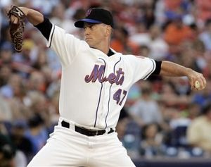 New York Mets pitcher Tom Glavine pitches to his 296th career victory against the Oakland Athletics