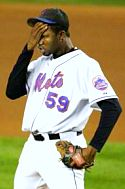 Mets pitcher Guillermo Mota reacts after yet another poor pitching performance