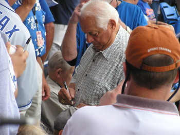 Tom Lasorda signs autograph at Tradition Field