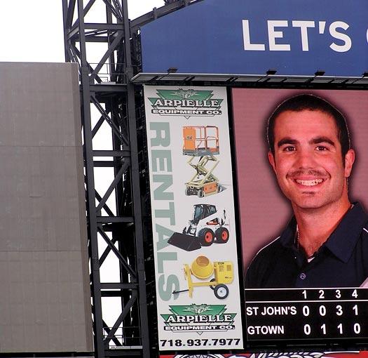Arpielle construction ad on Citi Field scoreboard