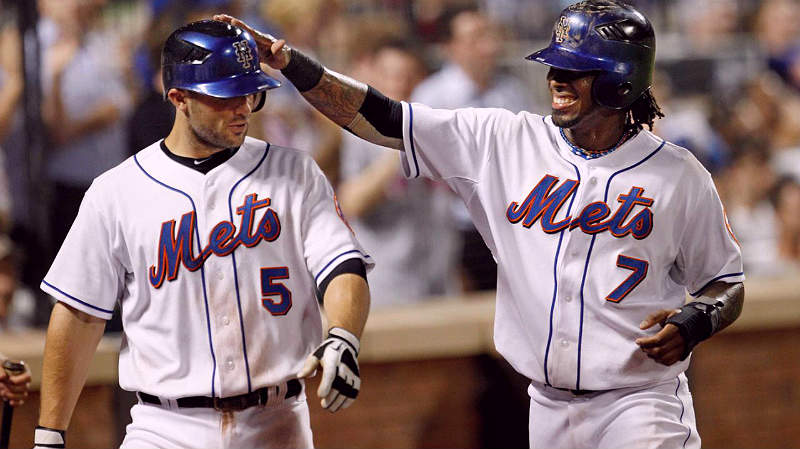 Jose Reyes taps on the head of David Wright of the New York Mets