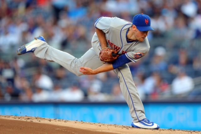 New York Mets starting pitcher Steven Matz (32) follows through on a pitch against the New York Yankees during the first inning at Yankee Stadium on Aug 3, 2016.