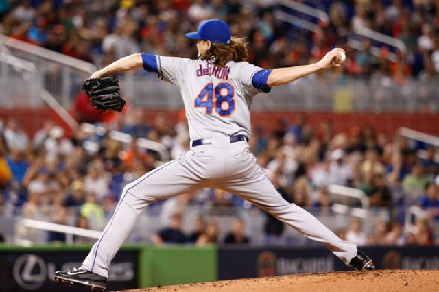 New York Mets pitcher Jacob deGrom during stride showing excessive adduction of shoulder